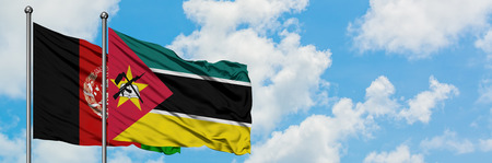 Afghanistan and Mozambique flag waving in the wind against white cloudy blue sky together. Diplomacy concept, international relations.