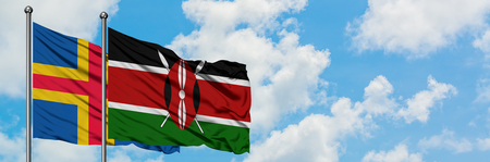 Aland Islands and Kenya flag waving in the wind against white cloudy blue sky together. Diplomacy concept, international relations.