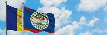 Andorra and Belize flag waving in the wind against white cloudy blue sky together. Diplomacy concept, international relations. Stock Photo