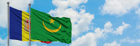 Andorra and Mauritania flag waving in the wind against white cloudy blue sky together. Diplomacy concept, international relations.