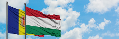 Andorra and Hungary flag waving in the wind against white cloudy blue sky together. Diplomacy concept, international relations. Imagens