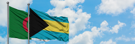 Algeria and Bahamas flag waving in the wind against white cloudy blue sky together. Diplomacy concept, international relations.