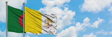 Algeria and Vatican City flag waving in the wind against white cloudy blue sky together. Diplomacy concept, international relations.