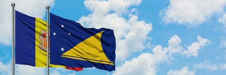 Andorra and Tokelau flag waving in the wind against white cloudy blue sky together. Diplomacy concept, international relations.