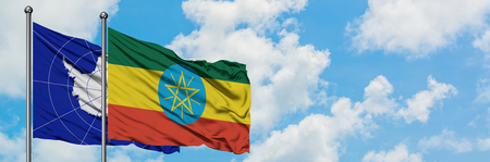 Antarctica and Ethiopia flag waving in the wind against white cloudy blue sky together. Diplomacy concept, international relations.