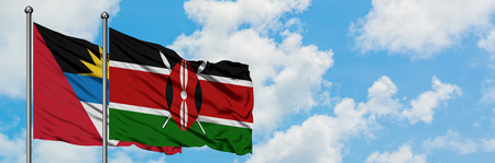 Antigua and Barbuda with Kenya flag waving in the wind against white cloudy blue sky together. Diplomacy concept, international relations.