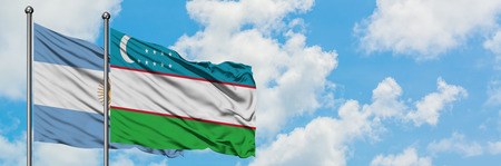 Argentina and Uzbekistan flag waving in the wind against white cloudy blue sky together. Diplomacy concept, international relations.