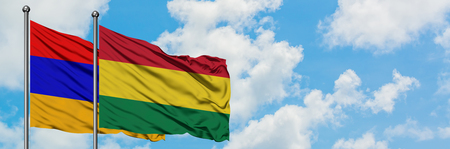 Armenia and Bolivia flag waving in the wind against white cloudy blue sky together. Diplomacy concept, international relations.