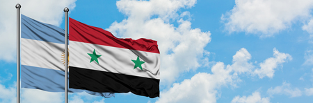 Argentina and Syria flag waving in the wind against white cloudy blue sky together. Diplomacy concept, international relations. Stock Photo