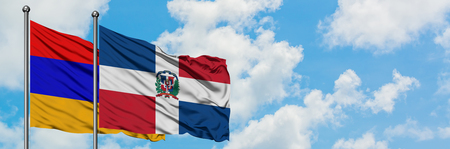 Armenia and Dominican Republic flag waving in the wind against white cloudy blue sky together. Diplomacy concept, international relations.