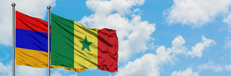 Armenia and Senegal flag waving in the wind against white cloudy blue sky together. Diplomacy concept, international relations.