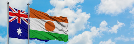 Australia and Niger flag waving in the wind against white cloudy blue sky together. Diplomacy concept, international relations.