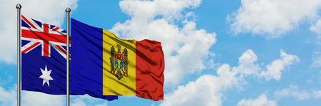 Australia and Moldova flag waving in the wind against white cloudy blue sky together. Diplomacy concept, international relations.