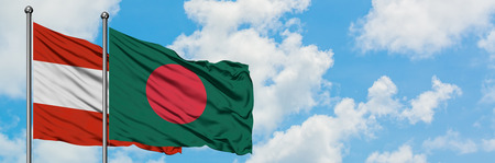 Austria and Bangladesh flag waving in the wind against white cloudy blue sky together. Diplomacy concept, international relations. Zdjęcie Seryjne