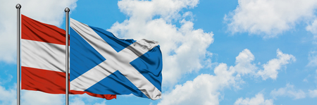 Austria and Scotland flag waving in the wind against white cloudy blue sky together. Diplomacy concept, international relations.