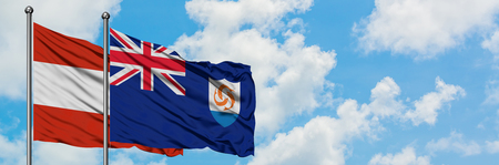 Austria and Anguilla flag waving in the wind against white cloudy blue sky together. Diplomacy concept, international relations.