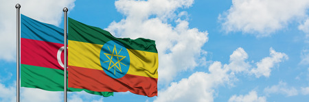 Azerbaijan and Ethiopia flag waving in the wind against white cloudy blue sky together. Diplomacy concept, international relations.