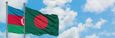 Azerbaijan and Bangladesh flag waving in the wind against white cloudy blue sky together. Diplomacy concept, international relations.