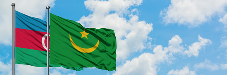 Azerbaijan and Mauritania flag waving in the wind against white cloudy blue sky together. Diplomacy concept, international relations.