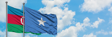 Azerbaijan and Somalia flag waving in the wind against white cloudy blue sky together. Diplomacy concept, international relations.