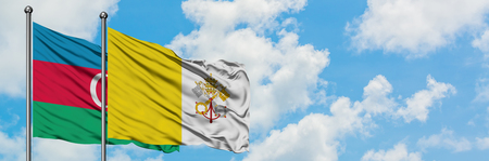Azerbaijan and Vatican City flag waving in the wind against white cloudy blue sky together. Diplomacy concept, international relations. 版權商用圖片