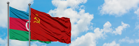 Azerbaijan and Soviet Union flag waving in the wind against white cloudy blue sky together. Diplomacy concept, international relations.