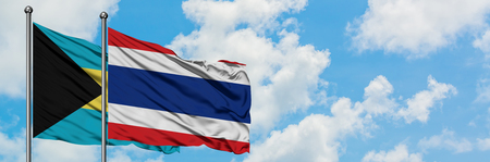 Bahamas and Thailand flag waving in the wind against white cloudy blue sky together. Diplomacy concept, international relations.