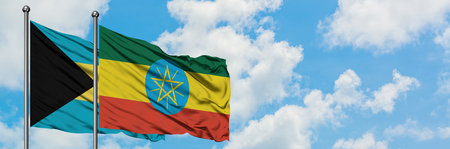 Bahamas and Ethiopia flag waving in the wind against white cloudy blue sky together. Diplomacy concept, international relations. Stock Photo - 123072195