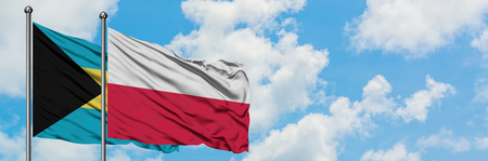 Bahamas and Poland flag waving in the wind against white cloudy blue sky together. Diplomacy concept, international relations.
