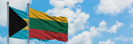 Bahamas and Lithuania flag waving in the wind against white cloudy blue sky together. Diplomacy concept, international relations.