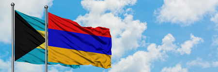 Bahamas and Armenia flag waving in the wind against white cloudy blue sky together. Diplomacy concept, international relations.