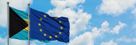 Bahamas and European Union flag waving in the wind against white cloudy blue sky together. Diplomacy concept, international relations.