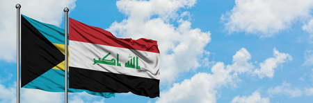 Bahamas and Iraq flag waving in the wind against white cloudy blue sky together. Diplomacy concept, international relations. Stock Photo