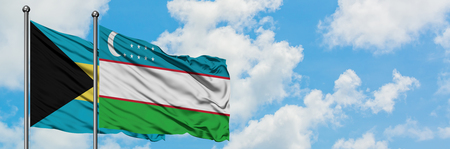 Bahamas and Uzbekistan flag waving in the wind against white cloudy blue sky together. Diplomacy concept, international relations.