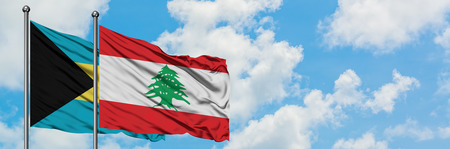 Bahamas and Lebanon flag waving in the wind against white cloudy blue sky together. Diplomacy concept, international relations. Stock Photo - 123073040