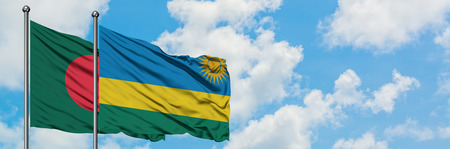 Bangladesh and Rwanda flag waving in the wind against white cloudy blue sky together. Diplomacy concept, international relations.