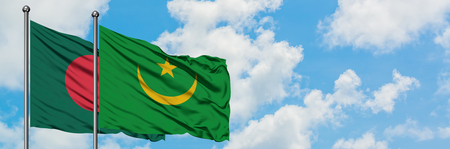 Bangladesh and Mauritania flag waving in the wind against white cloudy blue sky together. Diplomacy concept, international relations.