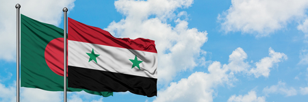 Bangladesh and Syria flag waving in the wind against white cloudy blue sky together. Diplomacy concept, international relations. Foto de archivo