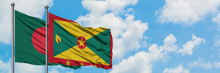 Bangladesh and Grenada flag waving in the wind against white cloudy blue sky together. Diplomacy concept, international relations.