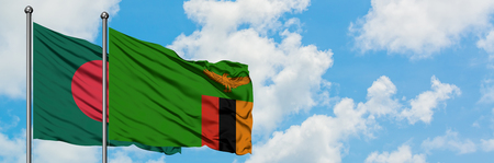 Bangladesh and Zambia flag waving in the wind against white cloudy blue sky together. Diplomacy concept, international relations. Foto de archivo