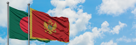 Bangladesh and Montenegro flag waving in the wind against white cloudy blue sky together. Diplomacy concept, international relations.
