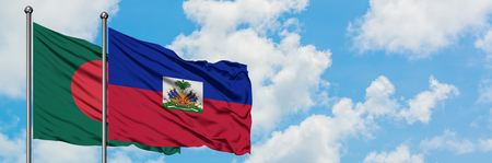 Bangladesh and Haiti flag waving in the wind against white cloudy blue sky together. Diplomacy concept, international relations.
