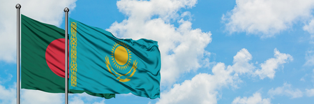 Bangladesh and Kazakhstan flag waving in the wind against white cloudy blue sky together. Diplomacy concept, international relations.