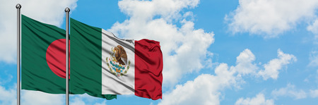 Bangladesh and Mexico flag waving in the wind against white cloudy blue sky together. Diplomacy concept, international relations.