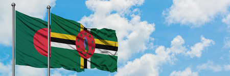 Bangladesh and Dominica flag waving in the wind against white cloudy blue sky together. Diplomacy concept, international relations.