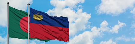 Bangladesh and Liechtenstein flag waving in the wind against white cloudy blue sky together. Diplomacy concept, international relations.