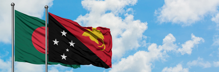 Bangladesh and Papua New Guinea flag waving in the wind against white cloudy blue sky together. Diplomacy concept, international relations. Stock Photo
