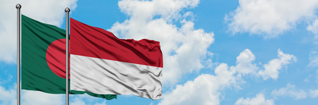 Bangladesh and Indonesia flag waving in the wind against white cloudy blue sky together. Diplomacy concept, international relations. Stock Photo