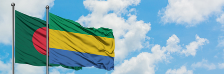 Bangladesh and Gabon flag waving in the wind against white cloudy blue sky together. Diplomacy concept, international relations. Foto de archivo