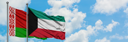 Belarus and Kuwait flag waving in the wind against white cloudy blue sky together. Diplomacy concept, international relations.